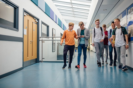 teenage boys walking in the school halls